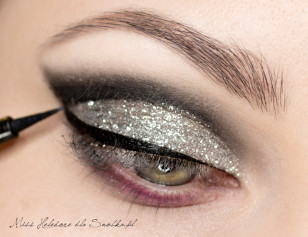 Follow distinct notch along the lash line with black eyeliner.  Please note that thoroughly covered the glitter.