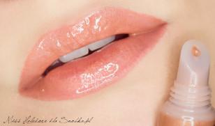 Dla dopełnienia całości usta pomaluj błyszczykiem w kolorze pralinki ze złotymi drobinkami. Gotowe!